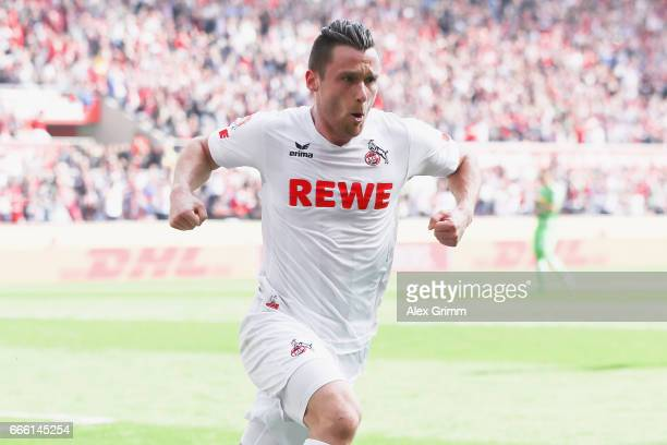 Christian Clemens of Koeln celebrates his team's first goal during the Bundesliga match between 1 FC Koeln and Borussia Moenchengladbach at...