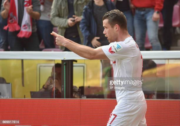 Christian Clemens of Koeln celebrates his team's first goal during the Bundesliga Match between 1FC Koeln and Borussia Moenchengladbach at...