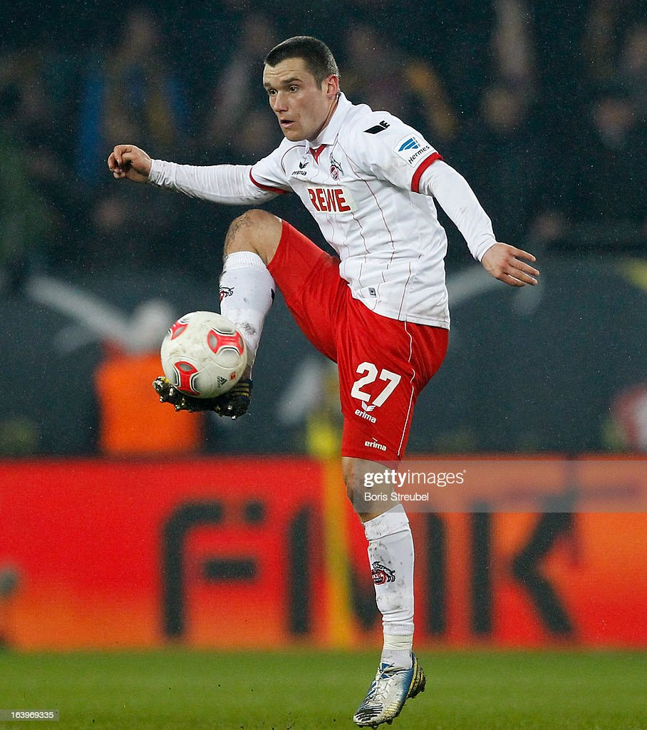 Christian Clemens of Koeln runs with the ball during the Second Bundesliga match between SG Dynamo Dresden and 1. FC Koeln at Gluecksgas-Stadion on March 18, 2013 in Dresden, Germany.