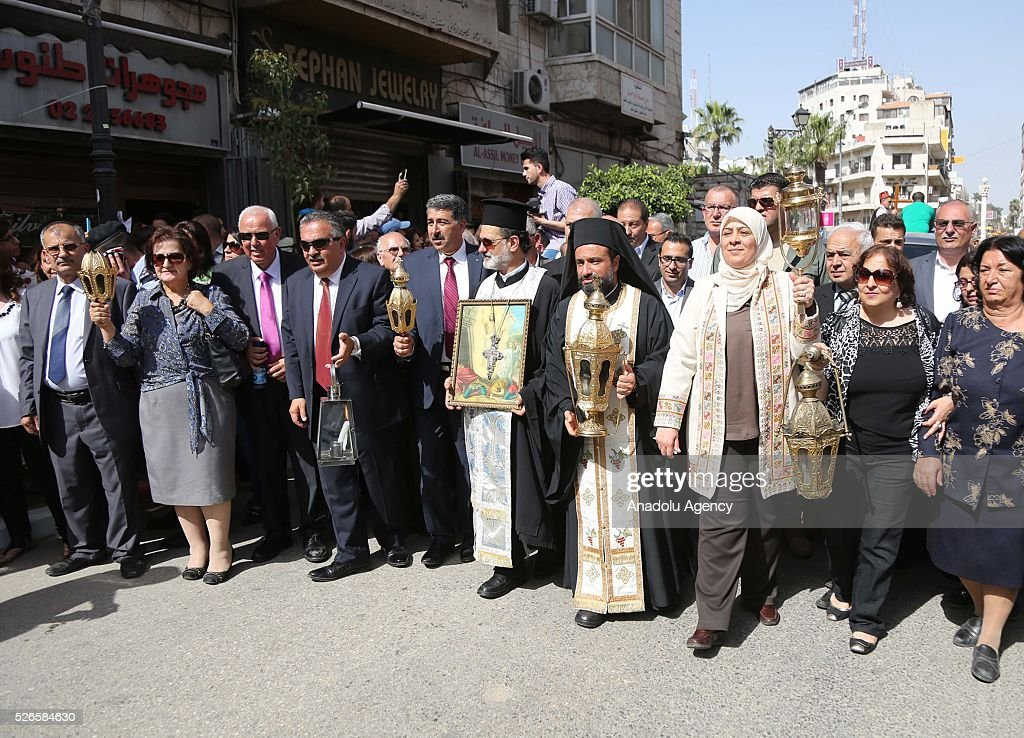 Christian clergymen attend the 'Holy Fire' parade on Holy Saturday ahead the Easter at the streets of Ramallah in West Bank on April 30, 2016. Holy Fire is described by Orthodox Christians as a miracle that occurs every year at the Church of the Holy Sepulchre in Jerusalem on Holy Saturday.