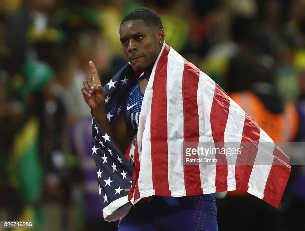 Christian Coleman of the United States waves his national flag during a lap of honour following his second place finish in the Men's 100 metres final...