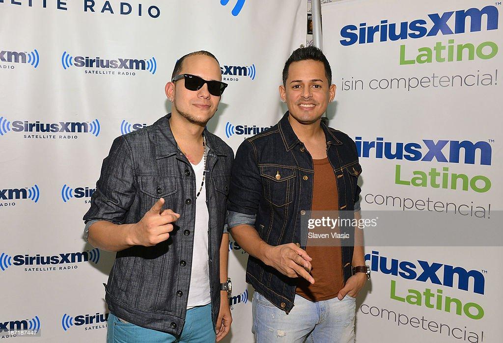 Christian Coln Rolon (L) and Angel Rivera Guzmn of 'Angel & Khriz' visit SiriusXM Studios on November 6, 2013 in New York City.
