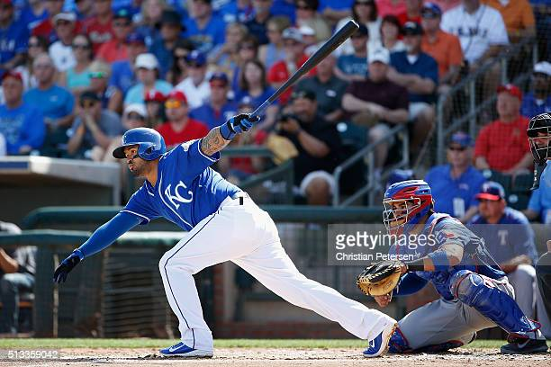 Christian Colon of the Kansas City Royals bats against the Texas Rangers during the first inning of the cactus leauge spring training game at...