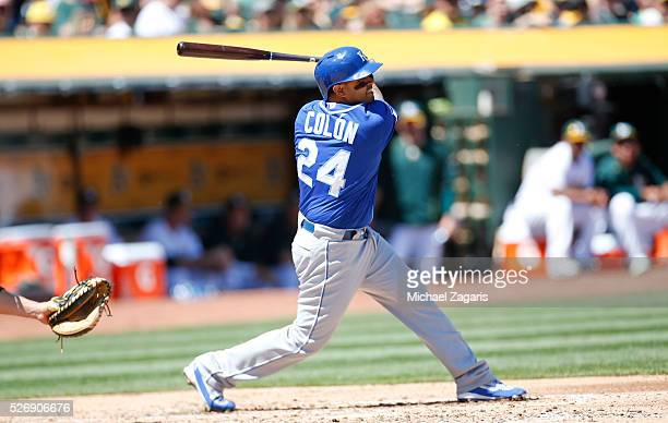 Christian Colon of the Kansas City Royals bats during the game against the Oakland Athletics at the Oakland Coliseum on April 17 2016 in Oakland...