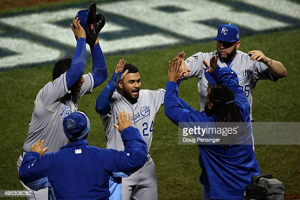 Christian Colon of the Kansas City Royals celebrates after scoring in the 12th inning against the New York Mets during Game Five of the 2015 World...