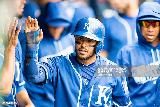 Christian Colon of the Kansas City Royals celebrates after scoring during the fifth inning against the Cleveland Indians at Progressive Field on May...