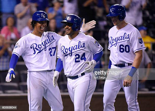 Christian Colon of the Kansas City Royals celebrates his threerun home run with Raul Mondesi and Hunter Dozier in the ninth inning against the...