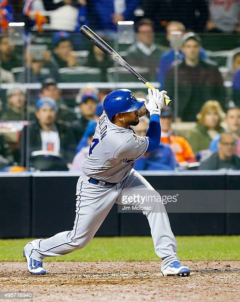 Christian Colon of the Kansas City Royals follows through on a 12th inning RBI base hit against the New York Mets during game five of the 2015 World...