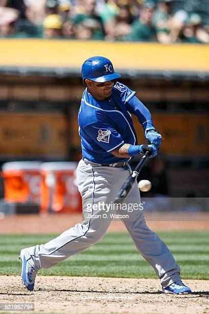 Christian Colon of the Kansas City Royals hits a single against the Oakland Athletics during the fifth inning at the Oakland Coliseum on April 17...