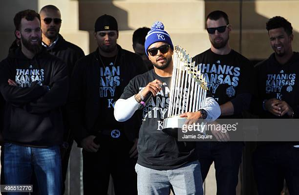 Christian Colon of the Kansas City Royals hols the trophy during a parade and celebration in honor of the Kansas City Royals' World Series win on...