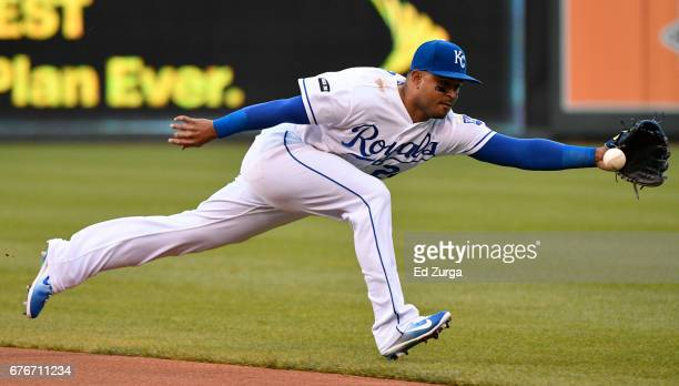 Christian Colon of the Kansas City Royals reaches out but can't stop a ball hit by Yolmer Sanchez of the Chicago White Sox in the first inning at...