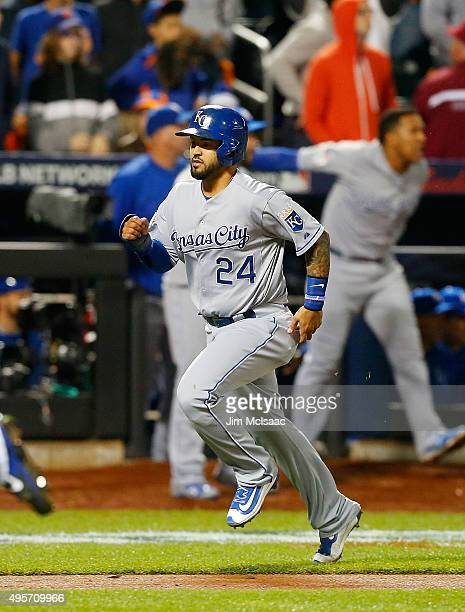 Christian Colon of the Kansas City Royals scores a run in the 12th inning against the New York Mets during game five of the 2015 World Series at Citi...