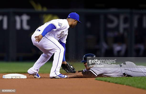 Christian Colon of the Kansas City Royals tags out Adam Eaton of the Chicago White Sox as he attempts to steal second during the 1st inning of the...