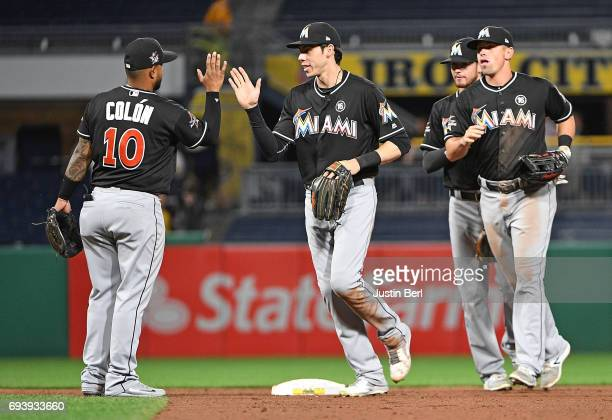 Christian Colon of the Miami Marlins celebrates with Christian Yelich after the final out in the Miami Marlins 71 win over the Pittsburgh Pirates at...
