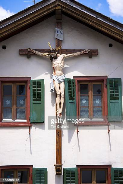 Christian crucifix on a traditional house in Mustair Switzerlan