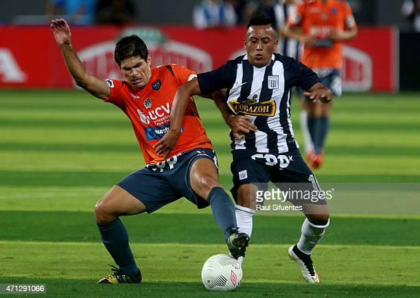 Christian Cueva of Alianza Lima struggles for the ball with Emiliano Ciucci of Cesar Vallejo during a final match between Alianza Lima and Cesar...