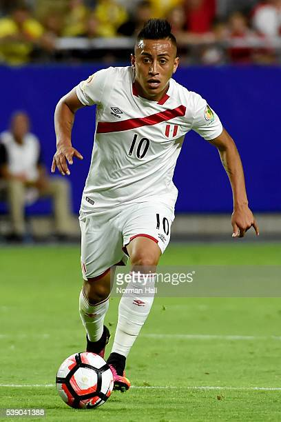 Christian Cueva of Peru brings the ball up field during a group B match between Ecuador and Peru at University of Phoenix Stadium as part of Copa...