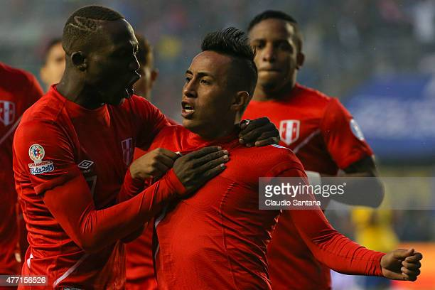 Christian Cueva of Peru celebrates with teammates after scoring the opening goal during the 2015 Copa America Chile Group C match between Brazil and...