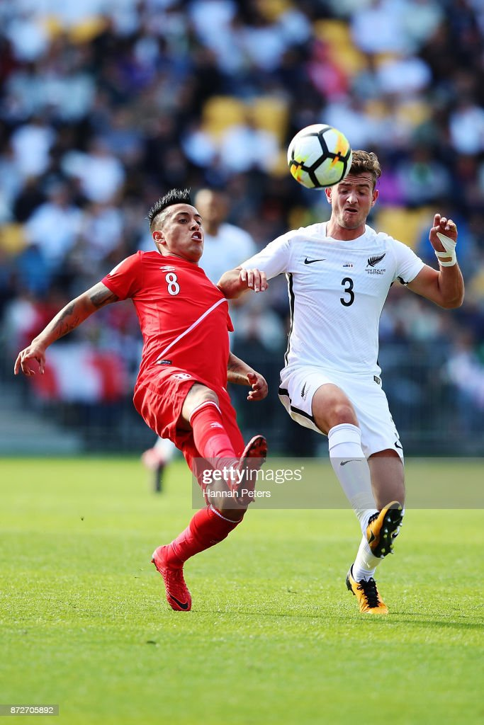 Christian Cueva of Peru competes with Deklan Wynne of the All Whites during the 2018 FIFA World Cup Qualifier match between the New Zealand All Whites and Peru at Westpac Stadium on November 11, 2017 in Wellington, New Zealand.