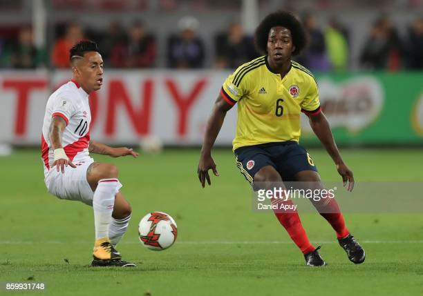 Christian Cueva of Peru fights for the ball with Carlos Sanchez of Colombia during a match between Peru and Colombia as part of FIFA 2018 World Cup...
