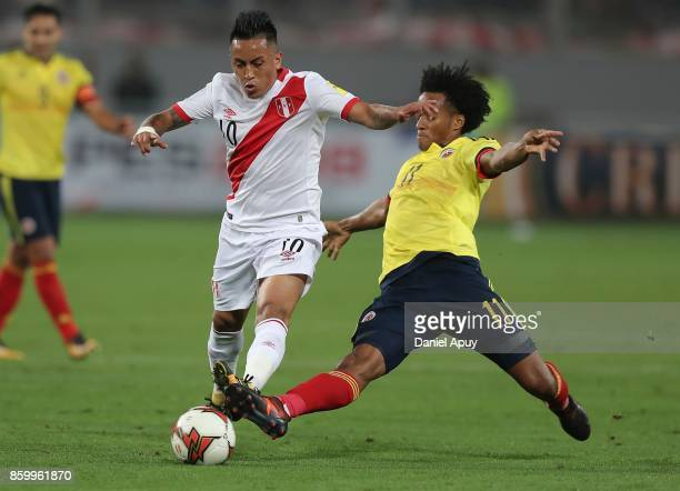 Christian Cueva of Peru fights for the ball with Juan Cuadrado of Colombia during a match between Peru and Colombia as part of FIFA 2018 World Cup...