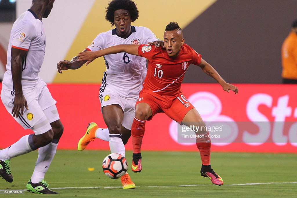 Christian Cueva of Peru is challenged by Carlos Sanchez of Colombia in action during the Colombia Vs Peru Quarterfinal match of the Copa America...