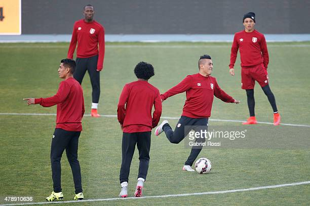 Christian Cueva of Peru kicks the ball during a field scouting prior to the semi final match against Chile at Nacional Stadium as part of 2015 Copa...