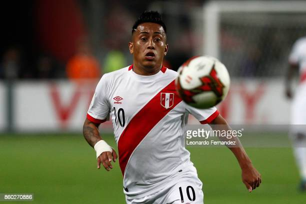 Christian Cueva of Peru looks at the ball during a match between Peru and Colombia as part of FIFA 2018 World Cup Qualifiers at National Stadium on...