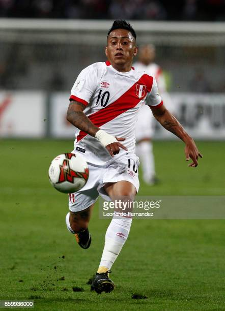 Christian Cueva of Peru plays the ball during match between Peru and Colombia as part of FIFA 2018 World Cup Qualifiers at National Stadium on...