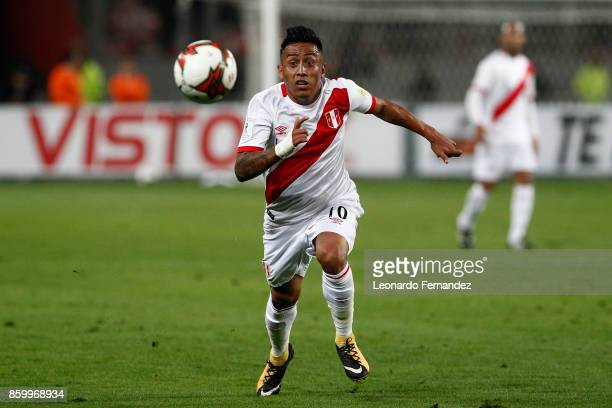 Christian Cueva of Peru runs for the ball during match between Peru and Colombia as part of FIFA 2018 World Cup Qualifiers at National Stadium on...