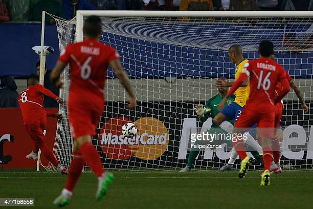 Christian Cueva of Peru shoots to score during the 2015 Copa America Chile Group C match between Brazil and Peru at Municipal Bicentenario Germán...