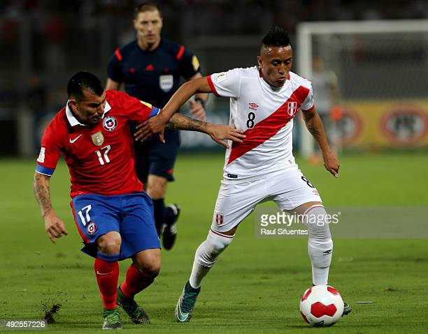 Christian Cueva of Peru struggles for the ball with Gary Medel of Chile during a match between Peru and Chile as part of FIFA 2018 World Cup...