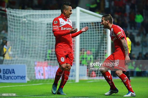 Christian Cueva of Toluca celebrates with Dario Botinelli after scoring the second goal of his team during the 11th round match between Toluca and...