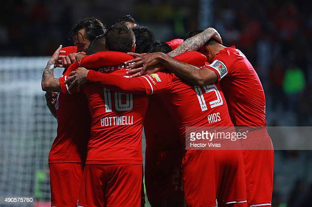 Christian Cueva of Toluca celebrates with teammates after scoring the second goal of his team during the 11th round match between Toluca and Tijuana...