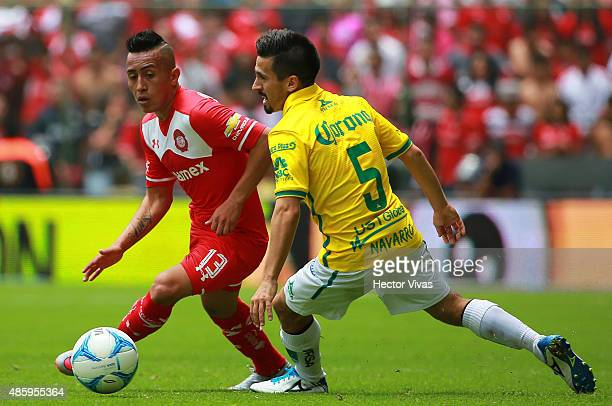 Christian Cueva of Toluca fights for the ball with Fernando Navarro of Leon during a 7th round match between Toluca and Leon as part of the Apertura...