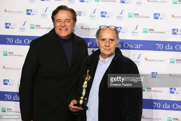 Christian De Sica and Marco Tamburella attend a photocall for Nastri D'Argento on March 22 2017 in Rome Italy