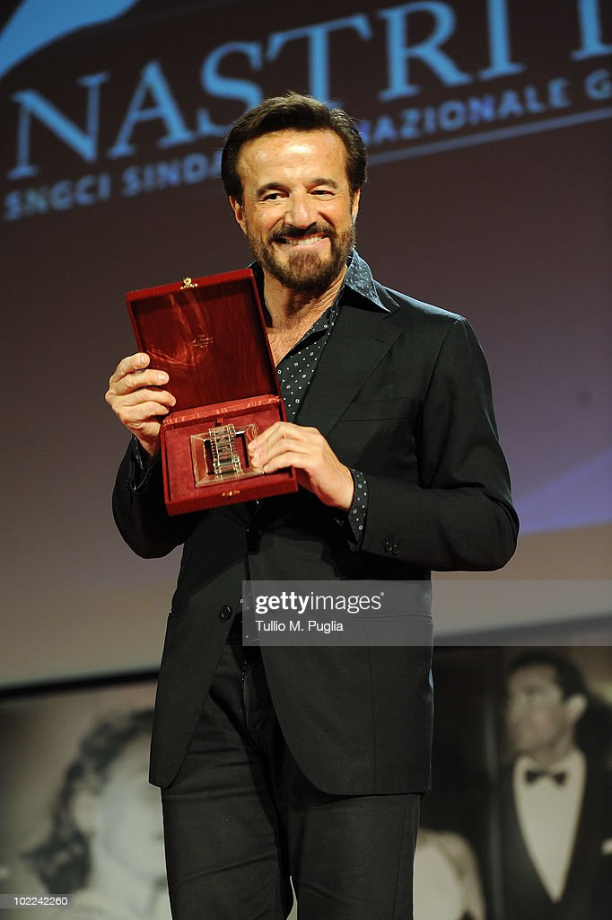Christian De Sica poses with the award for Best Actor (Ex Aequo) during the Nastri d'Argento ceremony awards on June 19, 2010 in Taormina, Italy.