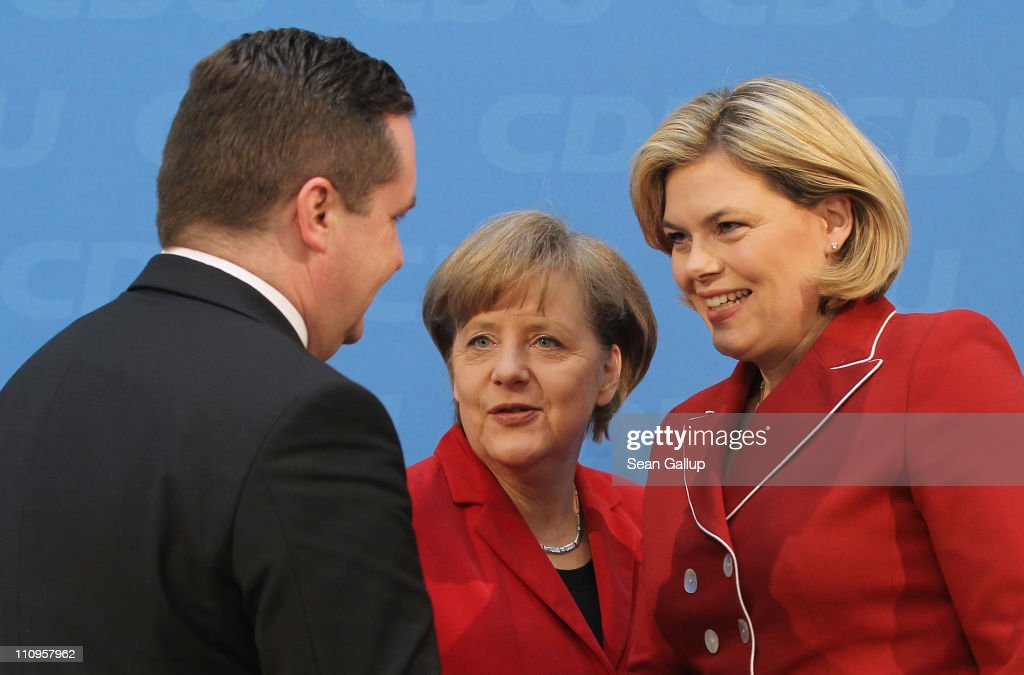 Christian Democratic (CDU) governor of Baden-Wuerttemberg Stefan Mappus, German Chancellor and leader of the CDU <a gi-track='captionPersonalityLinkClicked' href=/galleries/search?phrase=Angela+Merkel&family=editorial&specificpeople=202161 ng-click='$event.stopPropagation()'>Angela Merkel</a> and CDU candidate in Rhineland-Palatinate <a gi-track='captionPersonalityLinkClicked' href=/galleries/search?phrase=Julia+Kloeckner&family=editorial&specificpeople=6902085 ng-click='$event.stopPropagation()'>Julia Kloeckner</a> depart after speaking to the media the day after elections in Baden-Wuerttemberg and Rhineland-Palatinate on March 28, 2011 in Berlin, Germany. The CDU faired poorly in both elections and will likely lose its 57-year hold on power in Baden-Wuerttemberg.