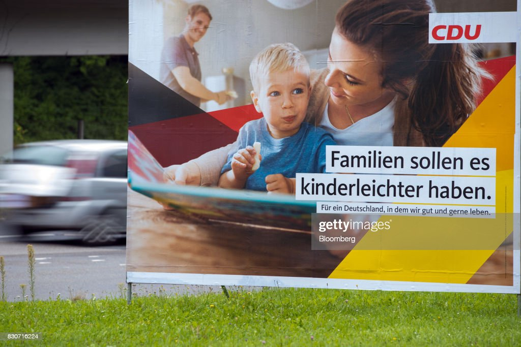 A Christian Democratic Union (CDU) election billboard stands in Dortmund, Germany, on Saturday, Aug. 12, 2017. Angela Merkel, Germany's chancellor and leader of the Christian Democratic Union (CDU), opened her re-election campaign with criticism of the nations auto executives, saying they need to embrace new technology more quickly to protect jobs and repair damage done by adiesel cheating scandal. Photographer: Jasper Juinen/Bloomberg via Getty Images