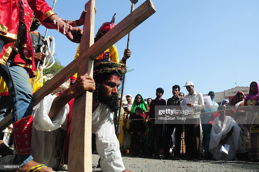 Christian devotees enact a scene of crucifixion of Jesus on the Cross at St Francis cathedral during Good Friday procession on April 3 2015 in Bhopal...