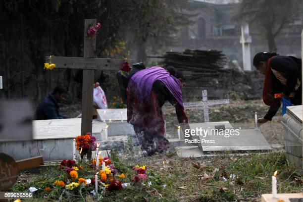 Christian devotees light candles during the commemoration of All Souls Day in a local cemetery in Srinagar the summer capital of Indian controlled...