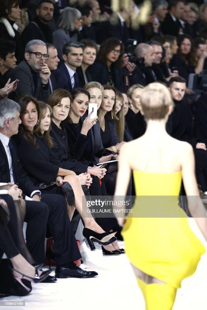 Christian Dior CEO Sidney Toledano and his wife Katia, French actress Isabelle Huppert, US actresses Sigourney Weaver, Jessica Alba and Leelee Sobieski, French actress Carole Bouquet, French jewellery designer Victoire de Castellane and Tunisian-born Azzedine Alaia attend the Christian Dior Haute Couture Spring-Summer 2013 collection show by Belgian designer Raf Simons on January 21, 2013 in Paris. AFP PHOTO / GUILLAUME BAPTISTE