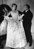 Christian Dior French couturier born in Normandy with one of his own designs a satin evening gown called Blenheim