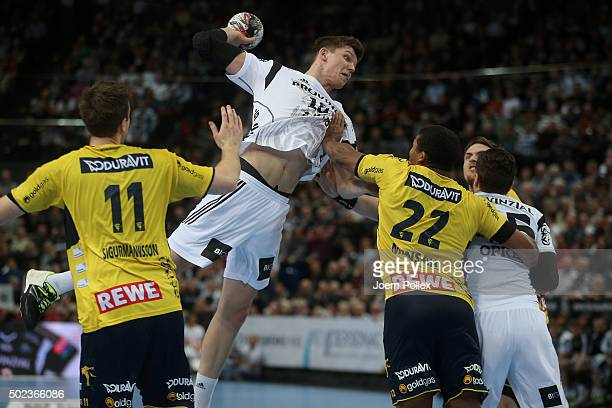 Christian Dissinger of Kiel scores during the DKB HBL Bundesliga match between THW Kiel and RheinNeckar Loewen at Sparkassen Arena on December 23...