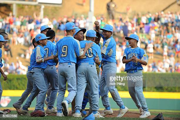 Christian Donahue of the Waipio LIttle League team is greeted on the mound by teammates after winning the World Series Championship game against the...