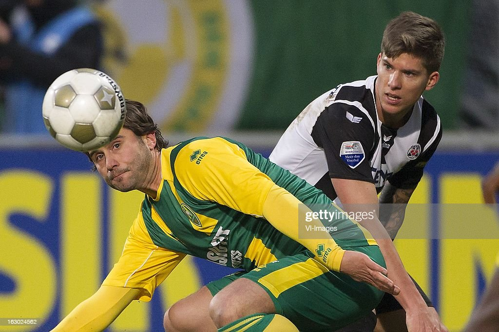 Christian Dorda of Heracles Almelo, Santi Kolk of ADO Den Haag during the Dutch Eredivisie match between ADO Den Haag and Heracles Almelo at the Kyocera Stadium on march 03, 2013 in The Hague, The Netherlands