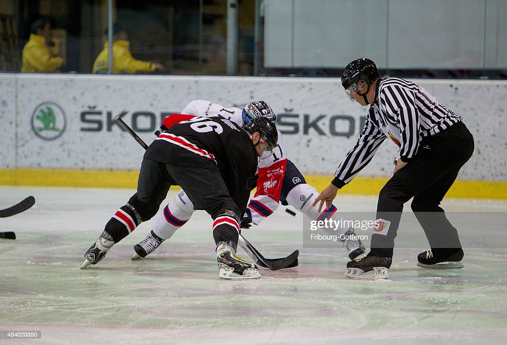 Christian Dube of Gotteron battles with Mark Bell of Berlin during the group stage match between Fribourg-Gotteron and Eisbaeren Berlin on August 23, 2014 in Fribourg, Switzerland.