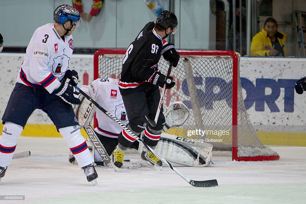 Christian Dube #96 of Gotteron scores to 1:0 during the group stage match between Fribourg-Gotteron and Eisbaeren Berlin on August 23, 2014 in Fribourg, Switzerland.