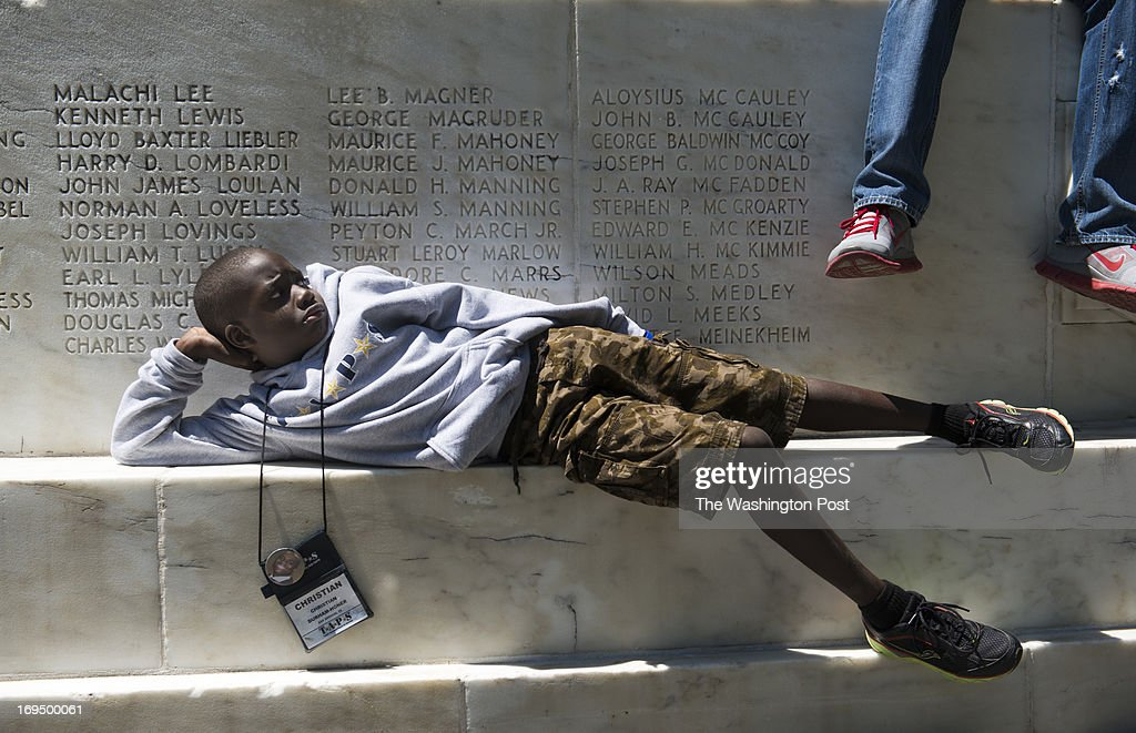 Christian Durham-Honer, 7, of San Antonio, Texas rests on the District of Columbia War Memorial in Washington, DC on May 25, 2013. Christian and other children participated in a scavenger hunt that led them to different memorial around the National Mall to search for their heroes names, such as the name of a relative who perished at war or even their own name. Tragedy Assistance Program for Survivors comforts families of the fallen from throughout at DC Area events over memorial day weekend. A record-breaking 2,200 participants participates in a five day weekend event this year, which offers two camps for children, workshops for adults , and comfort for the families of the service men and women who have died in service to our nation. Attendees include the families of those killed in action, those who died by suicide, and those who perished in training accidents or from sudden illnesses.
