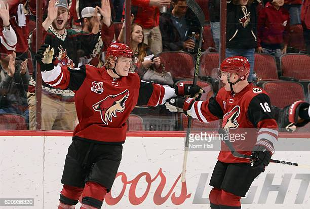 Christian Dvorak of the Arizona Coyotes celebrates with teammate Max Domi after his first period goal against the Nashville Predators at Gila River...